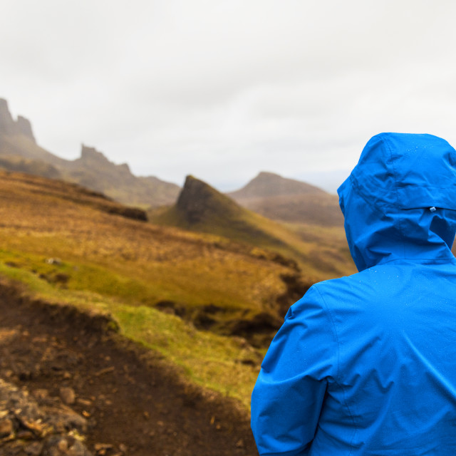 """Man in rain jacket at Quiraing, Isle of Skye"" stock image"