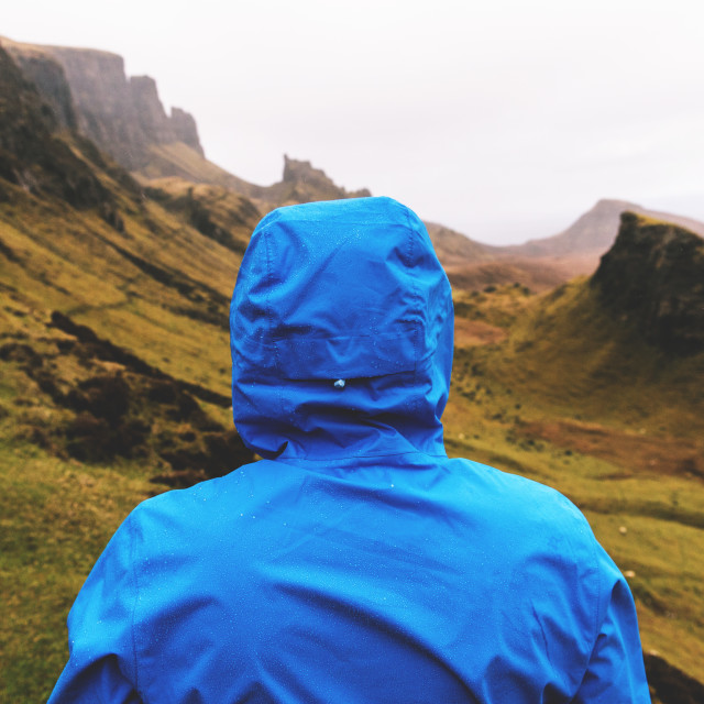 """Man standing in the rain at Quiraing, Isle of Skye, Scotland"" stock image"