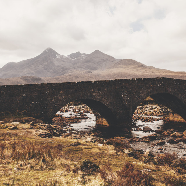 """Cuillin bridge and mountains on Isle of Skye, Scotland"" stock image"