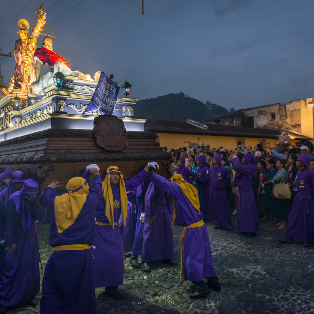 """""""Penitents carrying a float with the image of Jesus Christ in an Easter procession at night during the Holy Week in Antigua, Guatemala"""" stock image"""