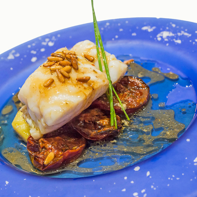 """""""Cod with confit tomato."""" stock image"""