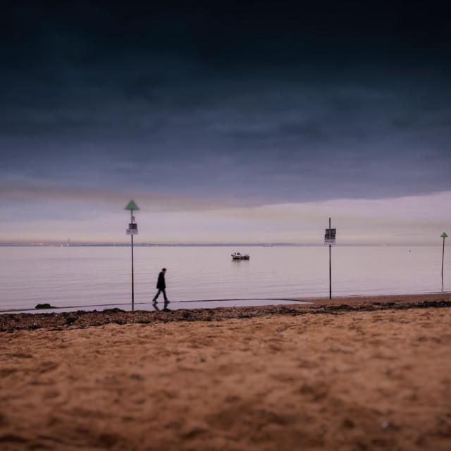 """Man Walking The Beach"" stock image"