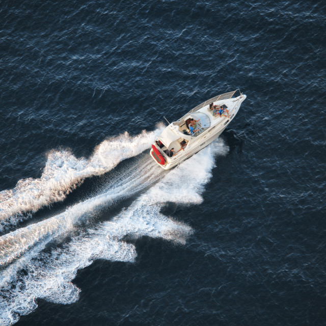 """People having fun in a boat"" stock image"
