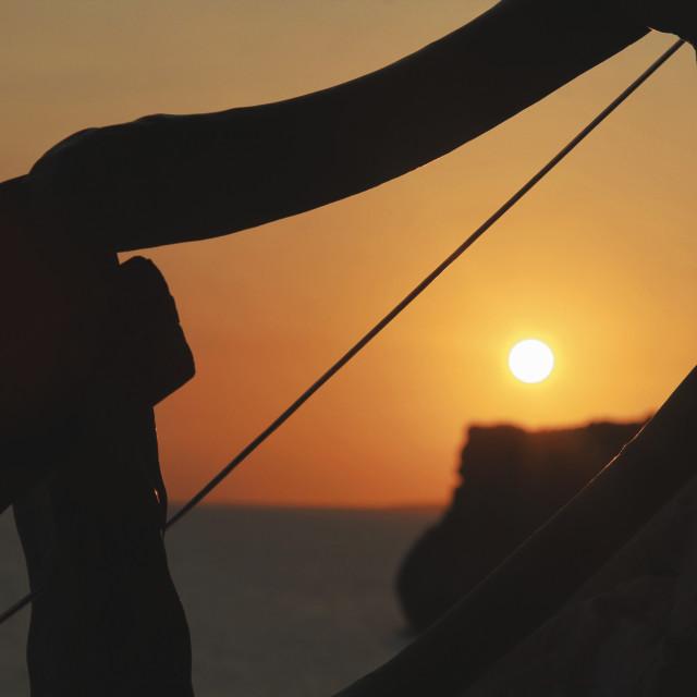 """Sunset through handrail"" stock image"
