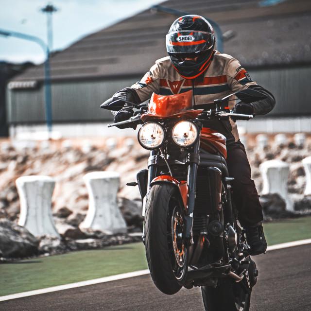 """""""Man riding his motorbike"""" stock image"""