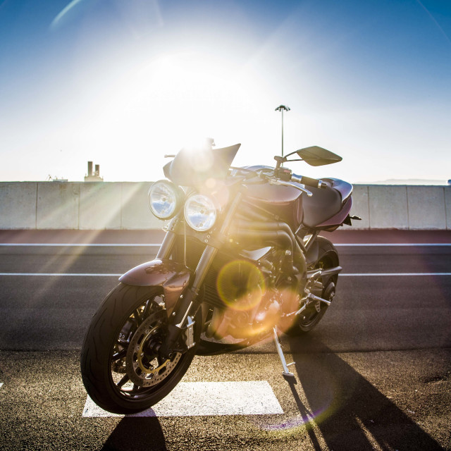 """Sun against the mortobike"" stock image"