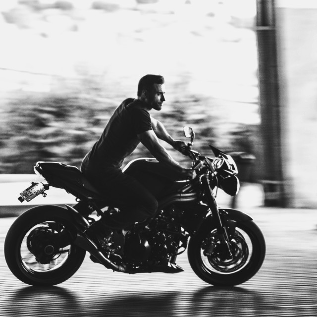 """""""Man riding motorbike"""" stock image"""
