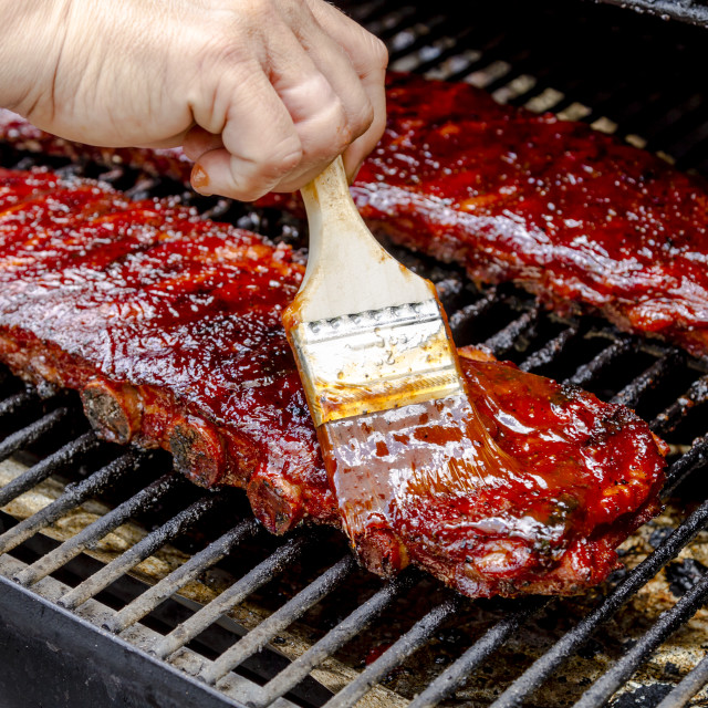 """Barbeque racks of ribs with sauce"" stock image"