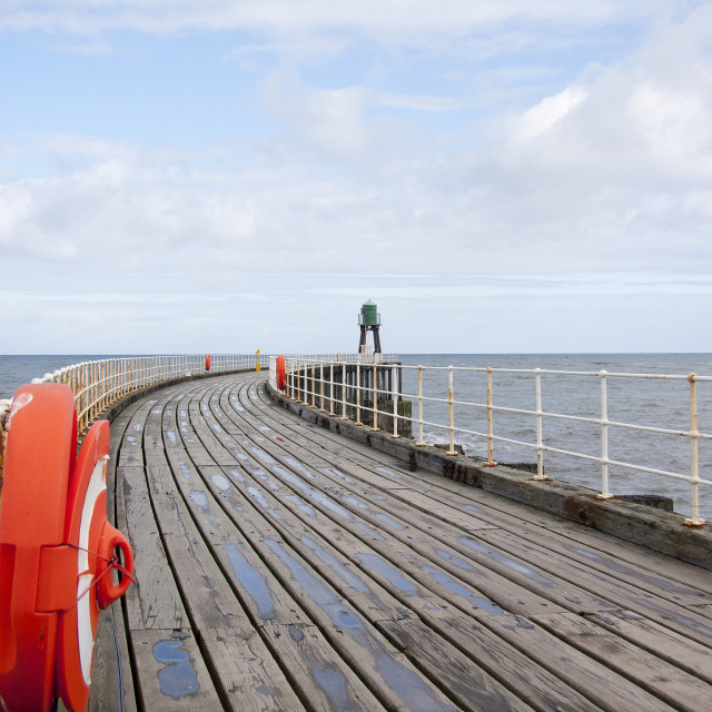 """""""View of a pier at Whitby, Yorkshire, England, showing the old wo"""" stock image"""