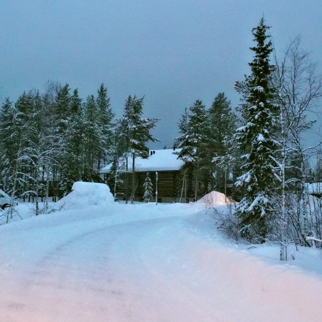 """Cabin at the end of a snowy path"" stock image"
