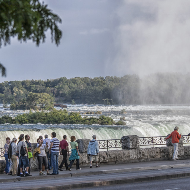"""Niagara Falls with tourists"" stock image"