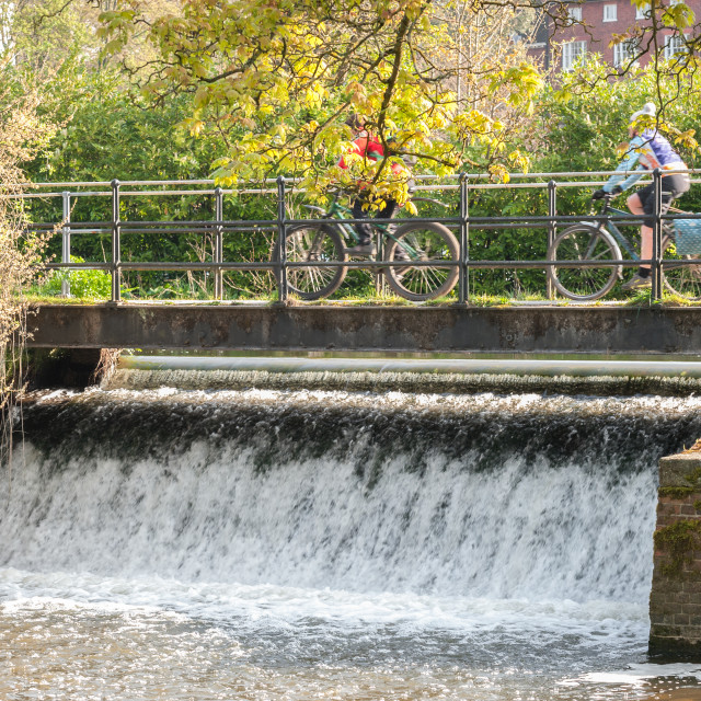 """cycling over a waterfall"" stock image"