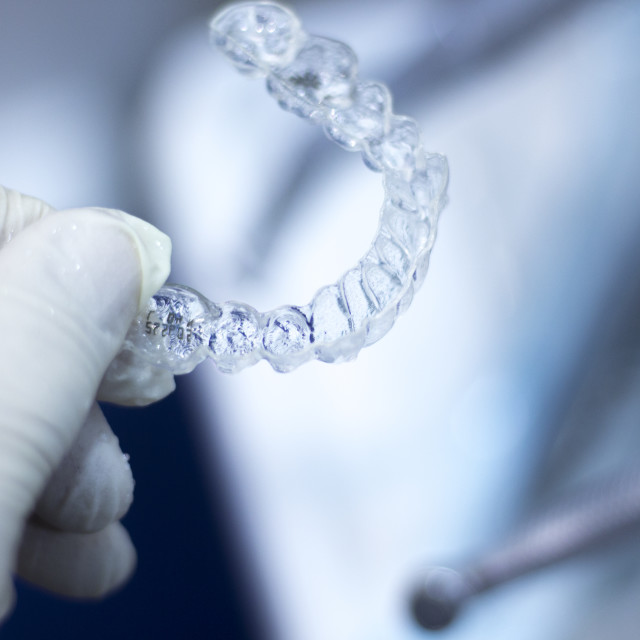 """Invisible dental aligner brackets"" stock image"