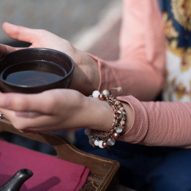 """""""hands holding cup full of tea"""" stock image"""
