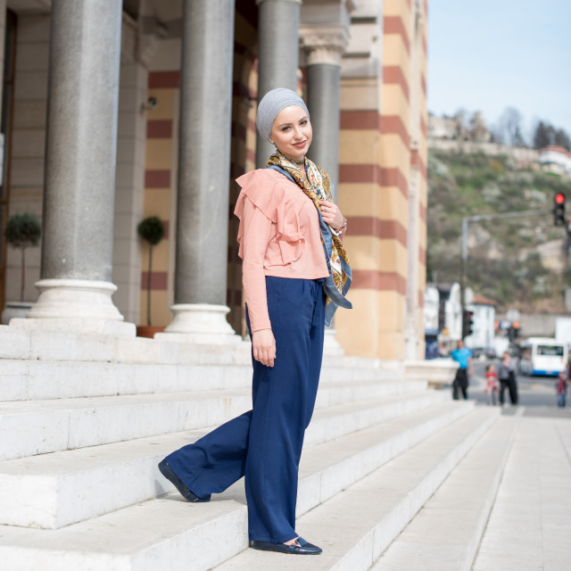 """young woman wearing hijab walking down the steps"" stock image"