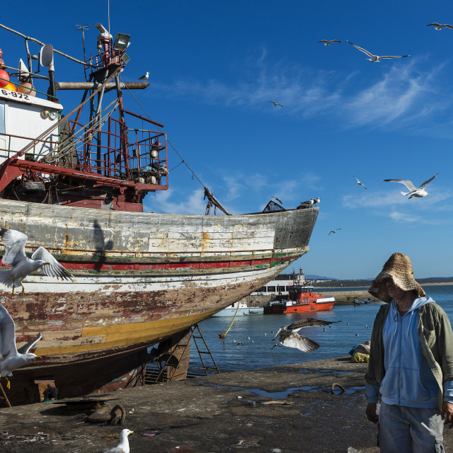 """Essaouira, Morocco - April 15, 2015: Fisherman in the fishing harbour of Essaoira in the Atlantic Coast of Morocco, Northern Africa."" stock image"
