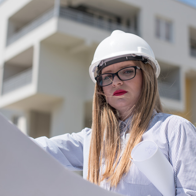 """""""woman engineer with plans"""" stock image"""