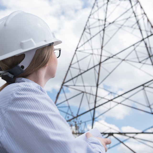 """""""woman engineer looking at power line"""" stock image"""