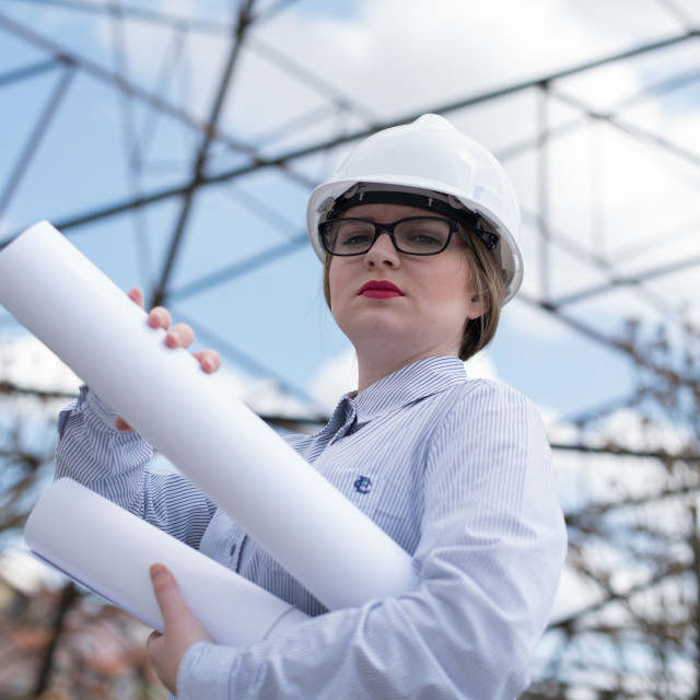 """""""young woman engineer in front of power line"""" stock image"""