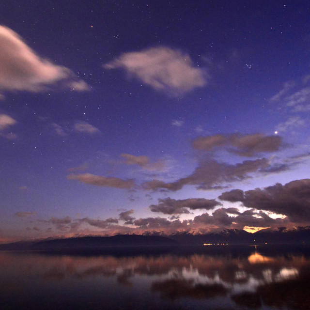 """Stars in the night sky. Sunset over Lake Prespa, Macedonia"" stock image"