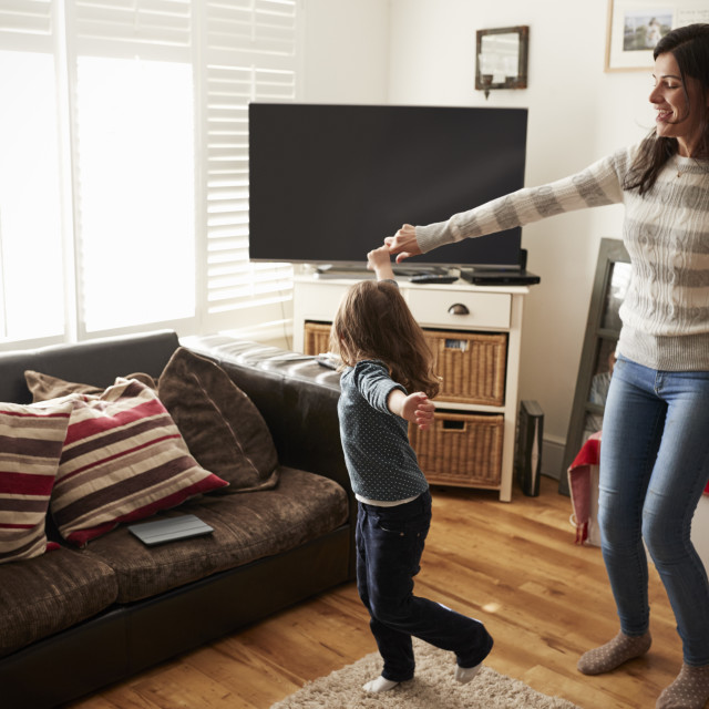 """Daughter Dances With Mother At Home"" stock image"