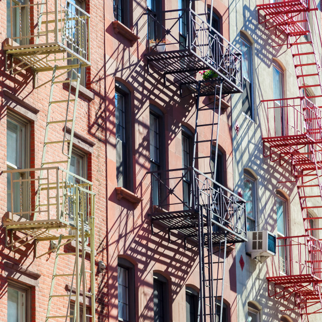 """building with fire escape stairs in NYC"" stock image"