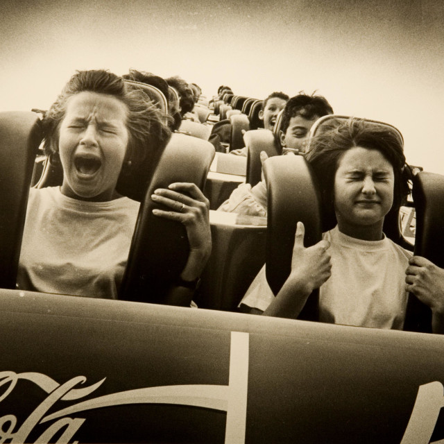 """""""Terrified kids on a rollercoaster"""" stock image"""