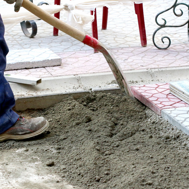 """Municipal construction workers paving"" stock image"