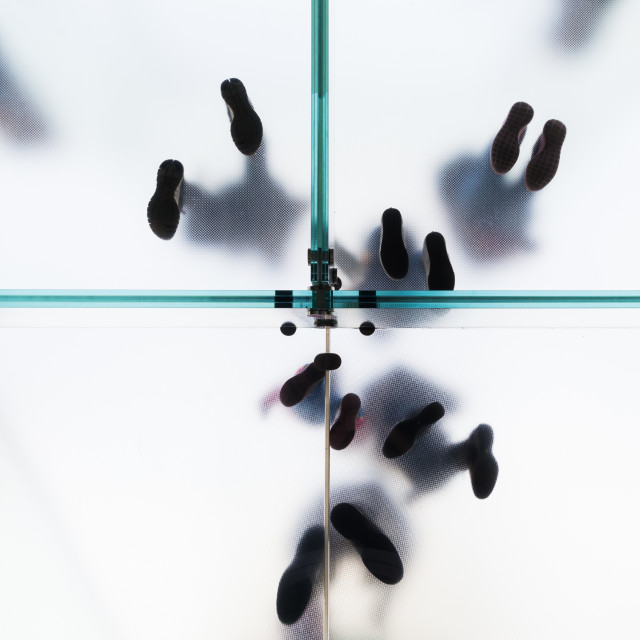 """feets on a glass floor"" stock image"