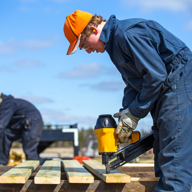 """Teenagers working with power tools"" stock image"