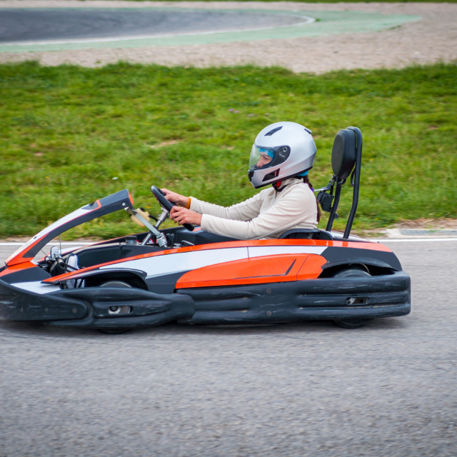 """Woman driving a kart"" stock image"