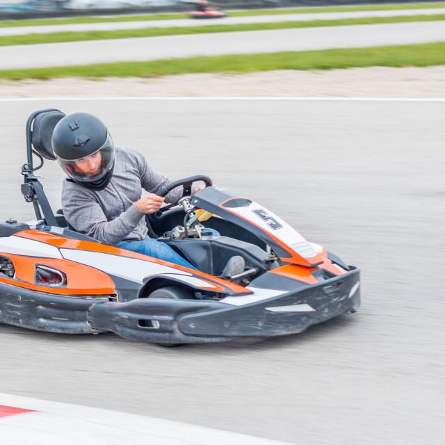 """Man driving a Kart"" stock image"