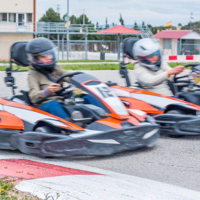 """Taking over in the karting race"" stock image"
