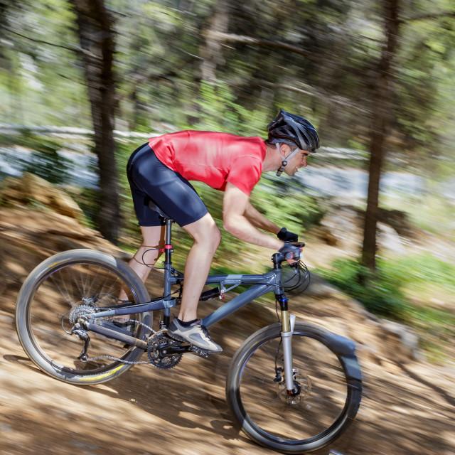 """Man riding a bike"" stock image"