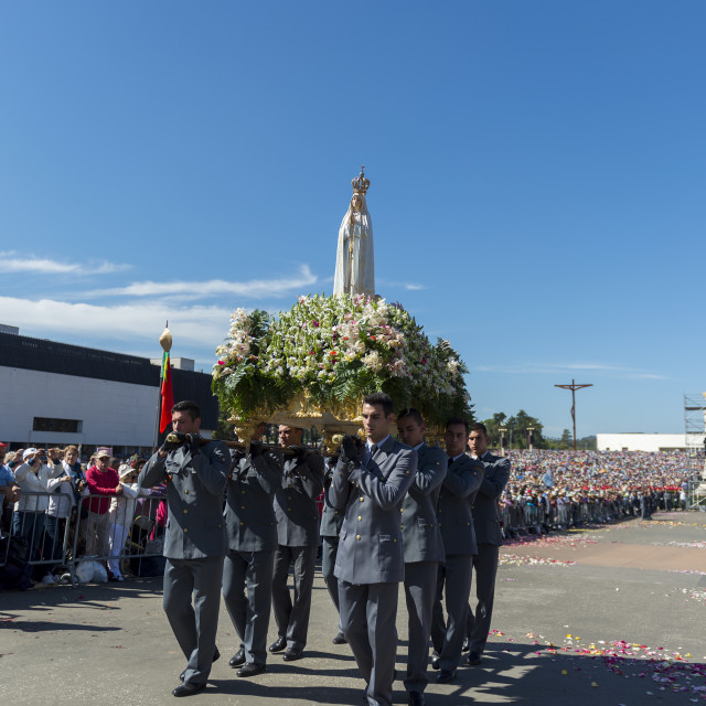 """""""Fatima, Portugal - May 13, 2014: Group of soldiers carrying the Statue of the Virgin Mary at the Sanctuary of Fatima during the celebrations of the apparition of the Virgin Mary in Fatima, Portugal."""" stock image"""