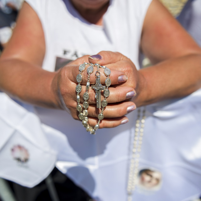 """""""Fatima, Portugal - May 13, 2014: Detail of a woman holding a rosary at the Sanctuary of Fatima during the celebrations of the apparition of the Virgin Mary in Fatima, Portugal."""" stock image"""