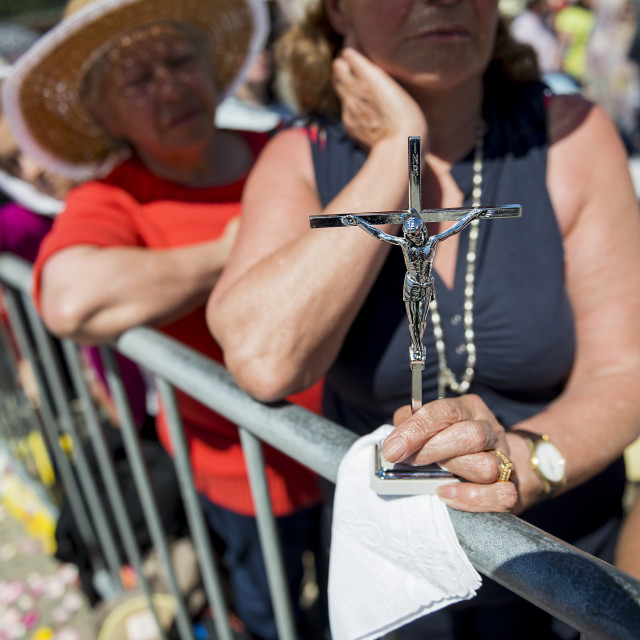 """""""Fatima, Portugal - May 13, 2014: Detail of a woman holding a crucifix at the Sanctuary of Fatima during the celebrations of the apparition of the Virgin Mary in Fatima, Portugal."""" stock image"""