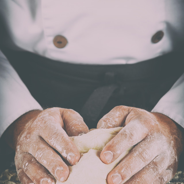 """""""Baker kneading dough with his hands"""" stock image"""