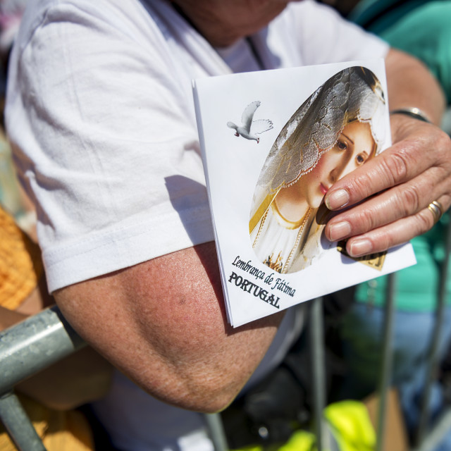 """""""Fatima, Portugal - May 13, 2014: Detail of a woman holding an image at the Sanctuary of Fatima during the celebrations of the apparition of the Virgin Mary in Fatima, Portugal."""" stock image"""