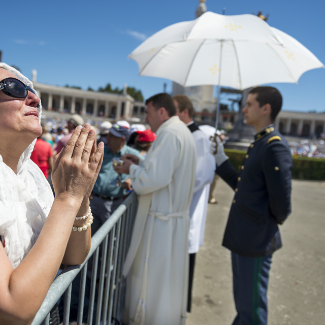 """""""Fatima, Portugal - May 13, 2014: Woman praying at the Sanctuary of Fatima during the celebrations of the apparition of the Virgin Mary in Fatima, Portugal."""" stock image"""