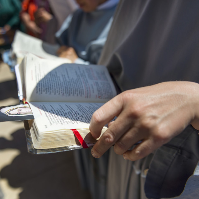 """""""Fatima, Portugal - May 13, 2014: Nun reading the bible at the Sanctuary of Fatima during the celebrations of the apparition of the Virgin Mary in Fatima, Portugal."""" stock image"""