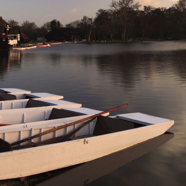 """Spring, April, May, June, Sunset over the Colourful wooden rowing boats for..."" stock image"