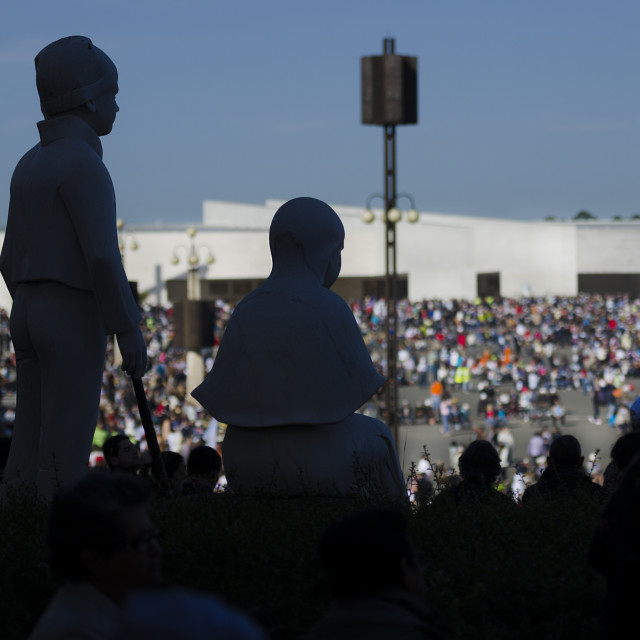"""""""Fatima, Portugal - May 13, 2014: Silhouete of the images of the litle shepherds at the Sanctuary of Fatima during the celebrations of the apparition of the Virgin Mary in Fatima, Portugal."""" stock image"""