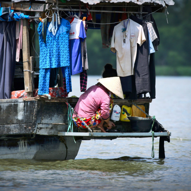"""Lady on a boat on the Mekong Delta"" stock image"