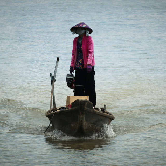 """Lady in a boat on the Mekong Delta"" stock image"