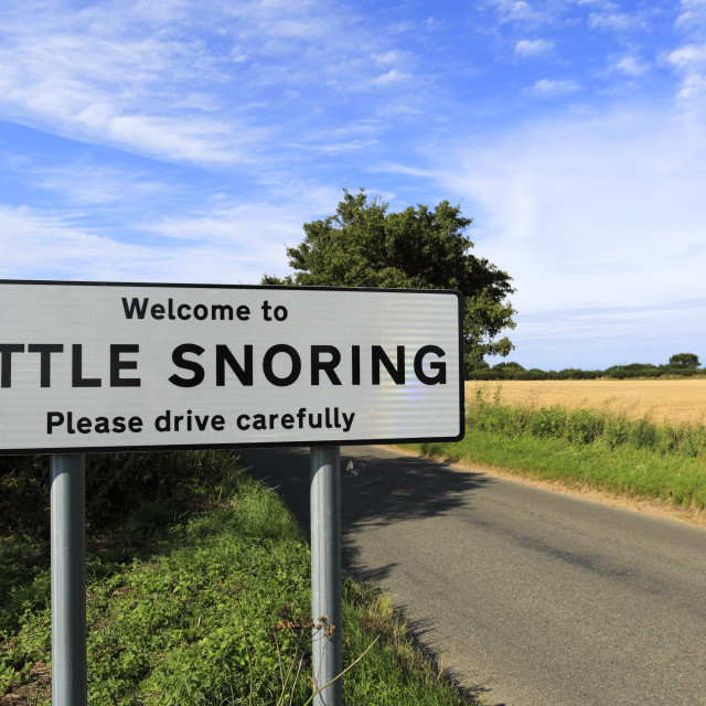 """""""Humorous Road sign in the village of Little Snoring, North Norfolk; England; UK"""" stock image"""