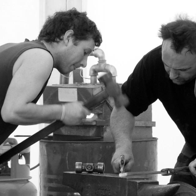 """""""Blacksmiths at work"""" stock image"""