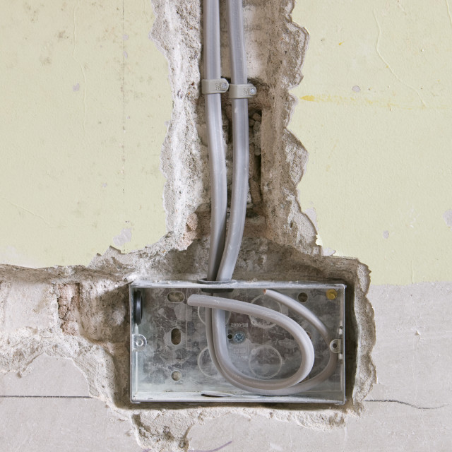 """""""Wiring a plug socket into a house wall UK"""" stock image"""