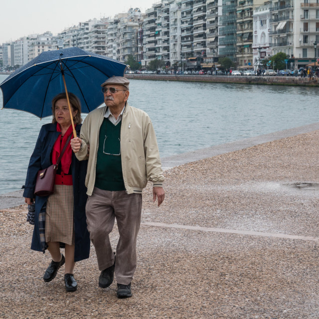 """""""Old Couple walking in the rain"""" stock image"""