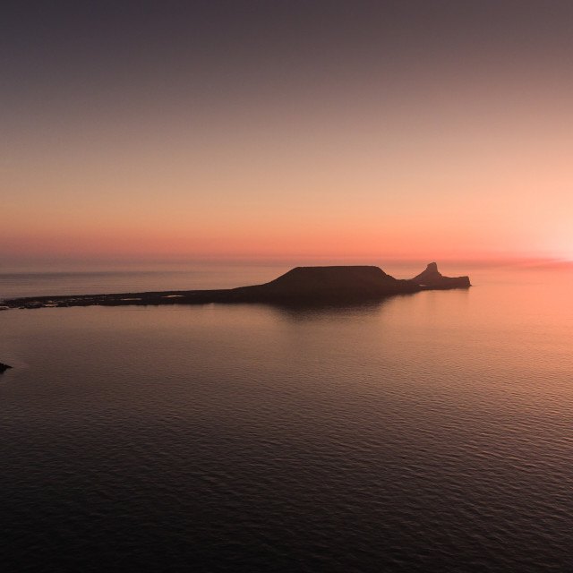 """Sunset at Worms Head Rhossili bay"" stock image"